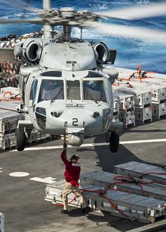 PACIFIC OCEAN (April 28, 2013) A crewmember aboard the Military Sealift Command Dry Cargo/Ammunition Ship USNS Richard E. Byrd (T-AKE 4) attaches cargo to an MH-60S Sea Hawk helicopter assigned to the Indians of Helicopter Sea Combat Squadron (HSC) 6 while conducting a replenishment at sea with the aircraft carrier USS Nimitz (CVN 68). Nimitz and Carrier Air Wing 11 recently left San Diego for a Western Pacific deployment. (U.S. Navy photo by Mass Communication Specialist 3rd Class Raul…