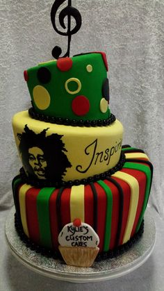 "Bob Marley Reggae Cake Hand painted image of Bob Marley on a topsy turvy cake with the Birthday boy's band ""Inspirie"" on it..."