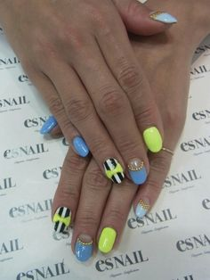 neon; yellow and blue nails; black and white accent; bow decoration; stripes; nail patterns