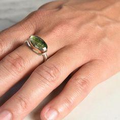 Petite, rose cut green tourmaline ring from Jamie Joseph. The asymmetric stone…