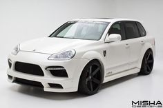Porsche Cayenne Wide Body Kit on white Cayenne 957 by Misha Designs. Click to view more photos and mod info.