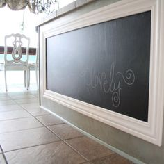 I wish I would have had this when my kids were little; chalkboard the height of a child in the kitchen; genius:)