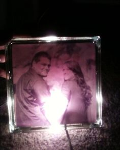 Glass block with photo printed on vellum. Use spray adhesive on backside of paper (not on glass) and adhere to block. Use LED light to illuminate.