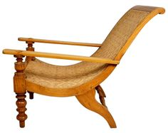 South Indian Caned Satinwood Planter's Chair  India  c. 1830-50  This Anglo Indian chair is hand crafted of solid satinwood, a precious wood generally reserved for inlay or veneer. This form of reclining chair was unique to the colonies during the Raj period and used primarily on verandas. This example displays turned front legs and supports for the long, plank arms, with a rolled back and splayed rear legs. It has been newly re-caned in the original pattern.