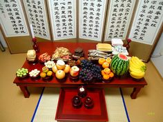 Chuseok: Jesasang - Many kinds of food such as wine, taro soup, beef, fish, three different colored vegetables, many kinds of fruits, and rice cake or songpyon, particularly those that were favored by the deceased.