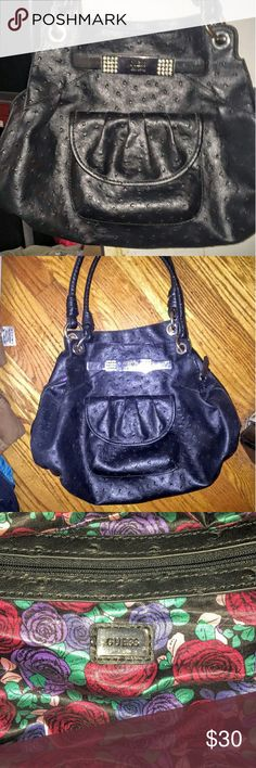 """Black leather Guess""""kimo"""" satchel! Has only been lightly used and is in wonderful condition! No scratches, sxraps, or tears on the outside of purse nor on the the inside lining.   COLOR: BLACK WITH ZIPPER CLOSURE AND SILVERTONE HARDWARE. DOUBLE STRAPS. STRAP: 7"""".  DIMENSIONS: 9.5"""" X 11.5"""" X 5"""". FRONT MAGNETIC SNAP POCKET. INSIDE BACK ZIP POCKET AND INSIDE FRONT HAS THREE OPEN POCKETS. Guess Bags Hobos"""