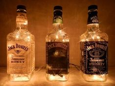 Jack Daniels bottles with white lights - A perfect man-cave addition. Jack Daniels bottles with white lights - A perfect man-cave addition. Festa Jack Daniels, Jack Daniels Bottle, Jack Daniels Wedding, Jack Daniels Party, Liquor Bottle Crafts, Alcohol Bottles, Wine Bottles, Liquor Bottle Lights, Bottle Lamps