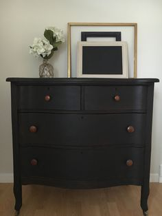 Super charming oak dresser is painted black, which gives it a rustic patina