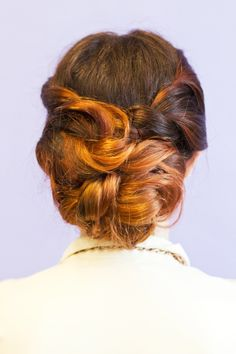 Twisted Updo Tutorial, easier than it looks (this one is in the 2nd half of the tutorial - first half is a double-waterfall braid, also lovely)