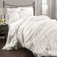 Bellamie is the essence of frilly and pretty. The layered ruffles create luxurious dimension as they cascade over the bed. The brushed poly fabrication is so so