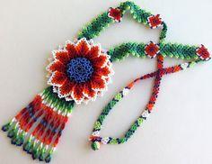 Huichol white, red and blue flower necklace by Aramara on Etsy (www.etsy.com/uk/people/Aramara)