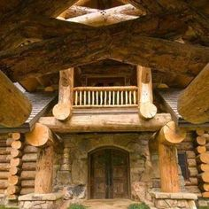 Did someone say massive logs! This is from the FB page of Wholesale log homes which captured the picture from magnumopus.com The combination of stone, logs, entry way and double doors is, to me, very attractive. www.cordwoodconstruction.org