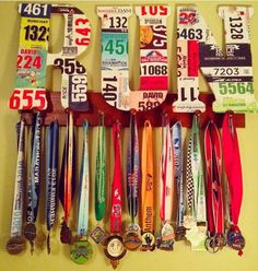 Medal hanging and bib art. Use letters and cover them with old race bibs