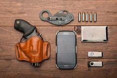 Take a look at another one of our employee's #EDC set-up and feel free share with us your own EDC rig!  Here are the details: - Taurus Ultra-Lite .38 Special - Bianchi Minimalist Holster - Winchester PDX1 Defender .38 Special +P 130gr HP Ammo - 5.11 C.U.B. Master 2.0 Tarani Karambit Folding Tactical Knife - Custom Engraved Business Card Holder - Samsung Galaxy S4 Phone