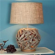 Driftwood Sphere Table Lamp This driftwood lamp is unique and perfect for rustic or coastal settings. A sphere of reclaimed pieces of driftwood houses a night light to make the driftwood glow with warm light. Indoor Crafts, Driftwood Lamp, Oval Coffee Tables, Water House, Table Lamp Shades, Rustic Lamps, Country Decor, Lighting, House Lamp