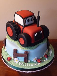 """This cake is made up of an 8"""" vanilla sponge as the base cake and topped with a tractor carved from vanilla sponge. The wheels are made from rice crispy and marshmellow treats. It takes inspiration from cakecentral.com/gallery/1461031 www.blossomcakesandbakes.co.uk www.facebook.com/blossomcakesandbakes"""