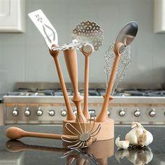 Beautiful kitchen utensils with wooden handles.