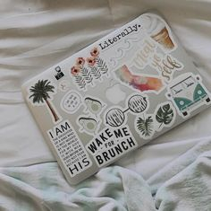 a new macbook with aesthetic stickers