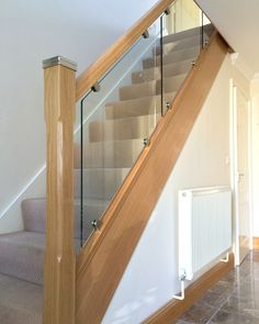 Steel and wood stairs with a glass handrail lead up to the second floor of this modern house. House Staircase, Staircase Railings, Banisters, Staircases, Oak Banister, Stair Handrail, Glass Handrail, Glass Stairs, Wood Stairs