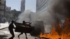 Brazil crisis: Rio police fire on rioters from church