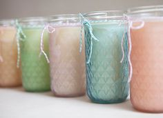 These stunning Tinted Mason Jar Candles make wonderful wedding centerpieces, gifts, or decorations.