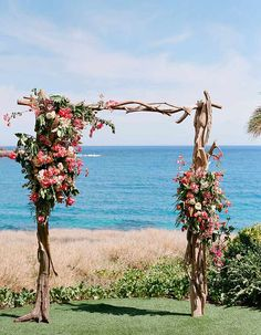 This Four Seasons Resort Lanai Wedding Is Your Ticket To Paradise: This bougainvillea and driftwood arbor is perfect for a beach wedding!