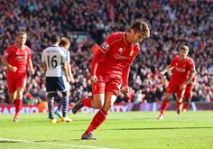 Adam Lallana celebrates his first goal as Liverpool go 1-0 up  HT 1-0