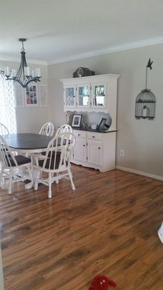 I love refurbishing furniture.... This is my dining room going from bland to chic.. I love it! First I started with removing all hardware including the hinges a…