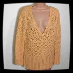 "Pale Yellow Spring Sweater This open weave spring sweater will definitely need a cami...just a simple addition to any wardrobe. It measures 19"" in the bust and is 26"" long. Sweaters V-Necks"