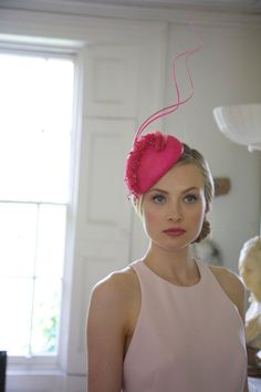 Handcrafted in our London studio. Straw cocktail hat with silk organza, swarovski crystals and beads.  Colours: Cerise Pink.  Secured with a comb and elastic.  Sent free within the UK.  Headpiece will be sent in a beautiful Black & White striped hatbox.
