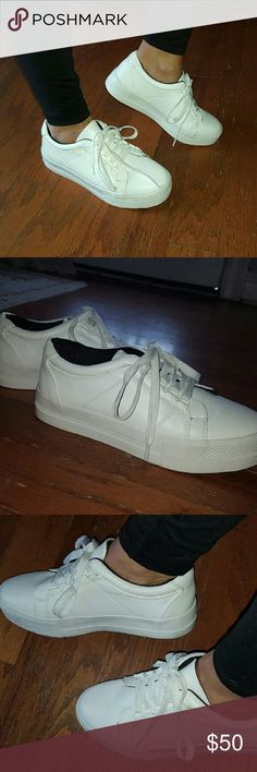 Benetton white sneakers I bought these in Paris at the Benetton. Just wore around the house. So they are really brand new. No scuffs. Dark blue inside shoe. It's a 38 European size. I wear an 8 and they fit perfectly. Benetton  Shoes Sneakers