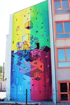 Etnik creates a new mural in Campobasso, Italy