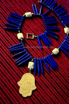 The Goldplated Hamsa Hand from Middle East with Islamic script along with Lapis Blue Howlite Spikes is sure to ward away all evil eyes ! Wear as a Statement piece and make heads turn ! Hamsa Hand, Tribal Jewelry, Statement Jewelry, Tassel Necklace, Urban, Beads, Silver, Handmade, Blue