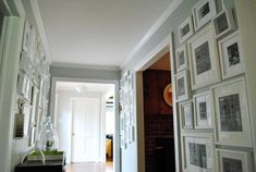 mismatched frames? In a future house, I love the idea of a hallway lined with photowalls on both sides...