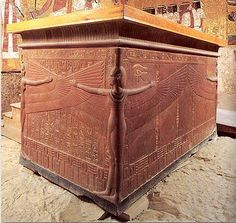 King Tutankhamun Sarcophagus. The box of this sarcophagus is made of fine brown quartzite and the cover is made of pink granite stained the color of the box. On the sarcophagus are the graceful figures of four goddesses: Isis, Nephthys, Neith and Selket, carved in high relief on the corners, their wings spread to protect the body in the sarcophagus.