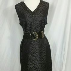 dana buchman sz 14 black on black animal print pit to pit -21/42  shoulder to hem - 37 waist - 19.5/39               hips - 22/44  weight - 9.9 oz's #danabuchman  #womenssize14  #littleblackdress  #perfectwithashrugover  #blackjewelsonfront around the vee neckline  #sleevelessdress  #animalprint  #toneontone  #rayonacrylicpolyesterotherfibers  45/28/24/3%  #handwashcoldlayflattodry #shimmery or sheen to the fabric on the lines of organza or damask fabric. #excellentcondition…