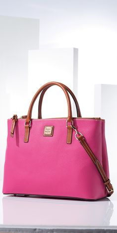 Dooney & Bourke Leather Willa Satchel. This stunning satchel features pebble grain leather and two interior zip compartments for secure storage. The detachable shoulder strap gives it the versatility you need during the day.