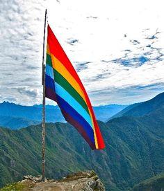 Cuzco flag atop a mountain
