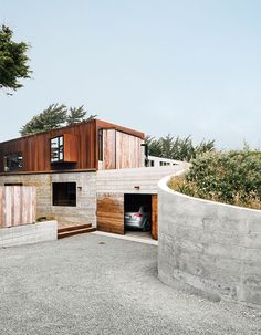 Cor-Ten steel and board-form concrete give the exterior a weathered look. Photo by: Mark Mahaney