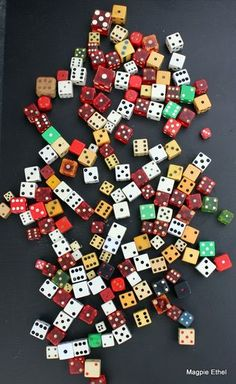 dice - dice - dice.  Bakelite, Plastic and Bone. Bone dice were carved by soldiers during the US Civil War. These dice are valuable and collectable on many levels.