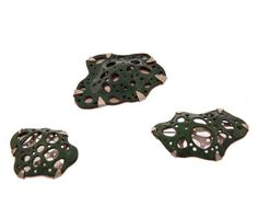 hydraulic pressed copper, enamel and saw pierced sterling silver brooches based on drawings of cross sections.