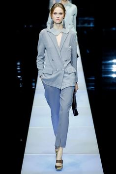 Showing on the final day of Milan Fashion Week, Giorgio Armani presented his trademark tailoring and menswear inspired looks for fall-winter 2015 with a focus on pants. In a color palette of moody blues, purples and grey, the Armani woman struts out in relaxed pants layered under oversized sweaters or a long overcoat. For the Italian designer, it is not about following the trends but offering timeless style for ...