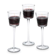 """Clear Lines Stemmed Trio  Item #:  P90597        Perfect for weddings and special occasions, our pulled stem glass holders feature a drizzled glass effect on the exterior. For use with votives and tealights, sold separately. Set includes one of each size: 6 1/2""""h, 7""""h and 7 1/2""""h."""