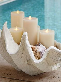 An oversize shell holding candles makes a wonderful accessory for a coastal casual home