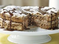 Hazelnut meringue cake with chocolate sauce