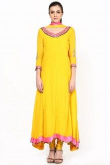 Yellow Crepe Suit Asymmetrical Hem With Combination Of Hot Pink And Nakshi Hand Work  Rs. 9,555