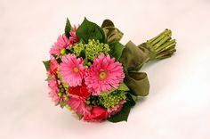 I am purchasing 'JQW Pink Gerbera Bouquet' from Jacques Flower Shop.