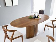 Calligaris  lovely wooden oval table, great blend of #contemporary and #classic