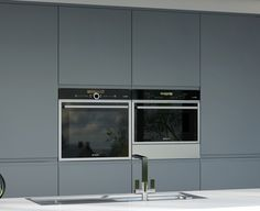 Grey Acrylic Cabinets In A Matte Finish.