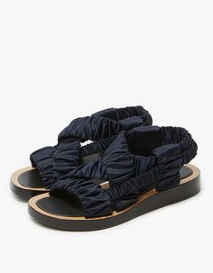 Modern sandals from 3.1 Phillip Lim in Dark Navy. Slingback design. Ruched satin crossover straps. Lightly padded footbed. Metal-studded stacked leather sole.   • Polyester Upper • Leather Sole